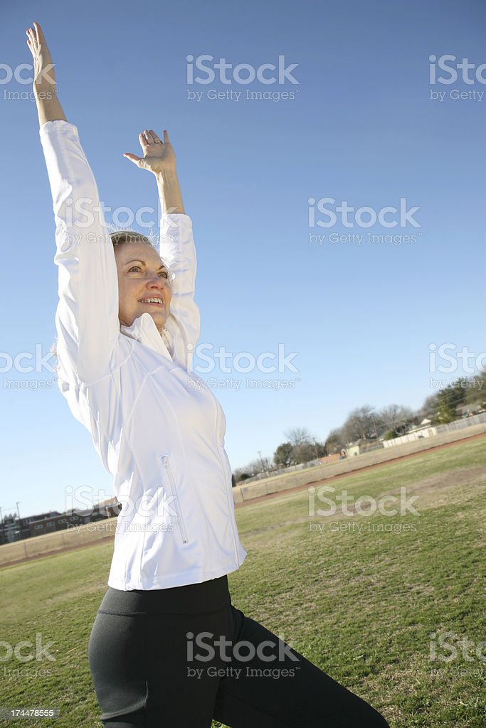 Mid Aged woman exercising outside royalty-free stock photo