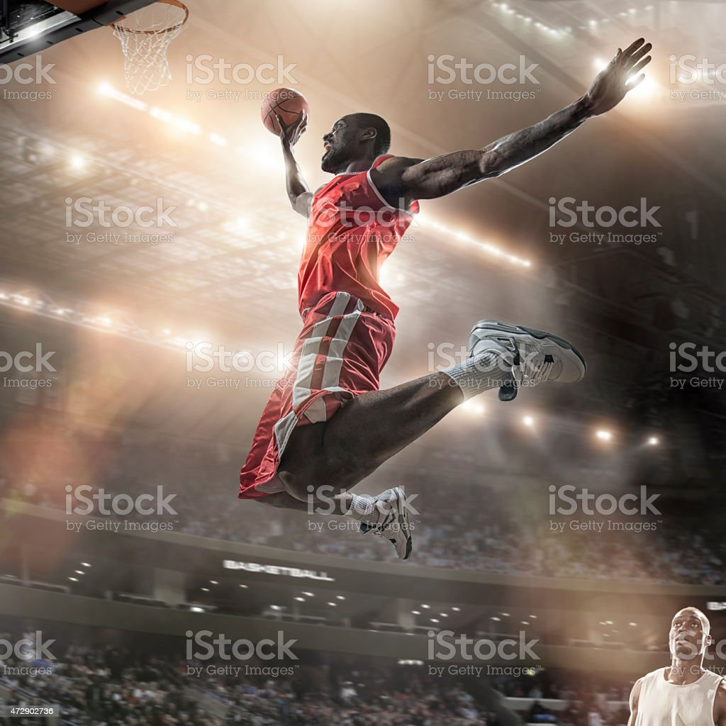 Mid Air Basketball Slam Dunk Jump stock photo