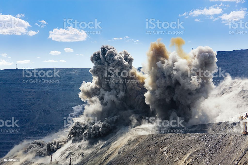 Mid blast shot in an open cast mining quarry stock photo
