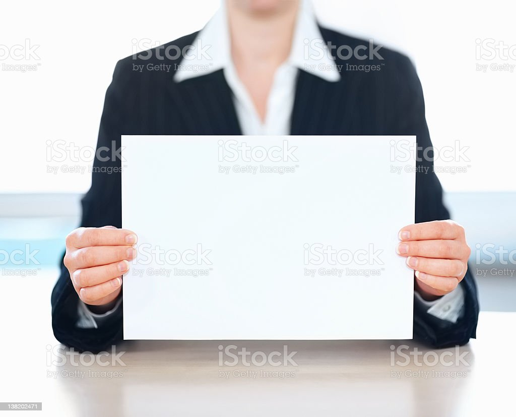Mid section of a business woman holding an empty billboard royalty-free stock photo