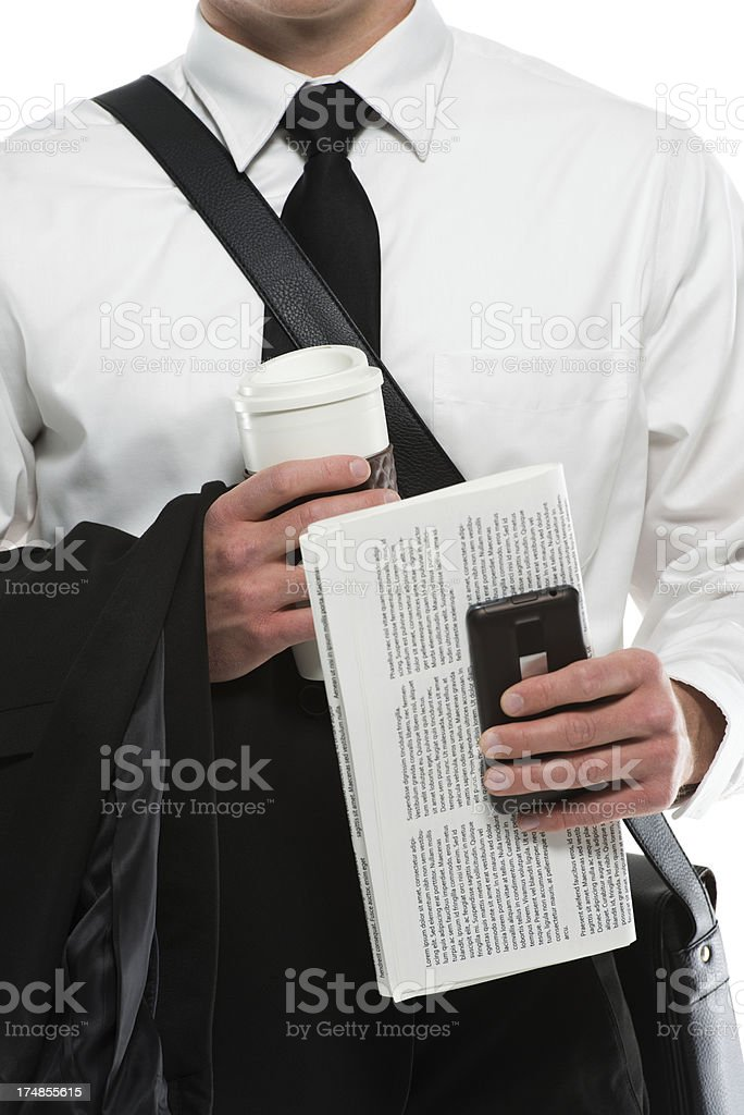 Mid section of a businessman with coffee,mobile and newspaper royalty-free stock photo