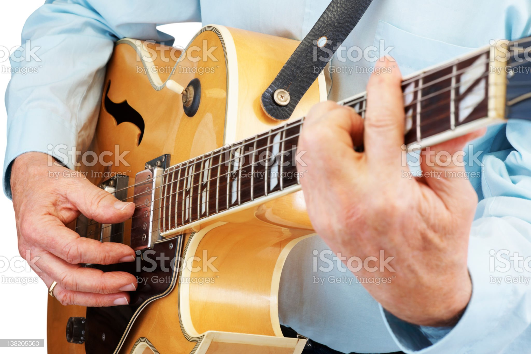 Mid section of a senior professional guitarist on white royalty-free stock photo
