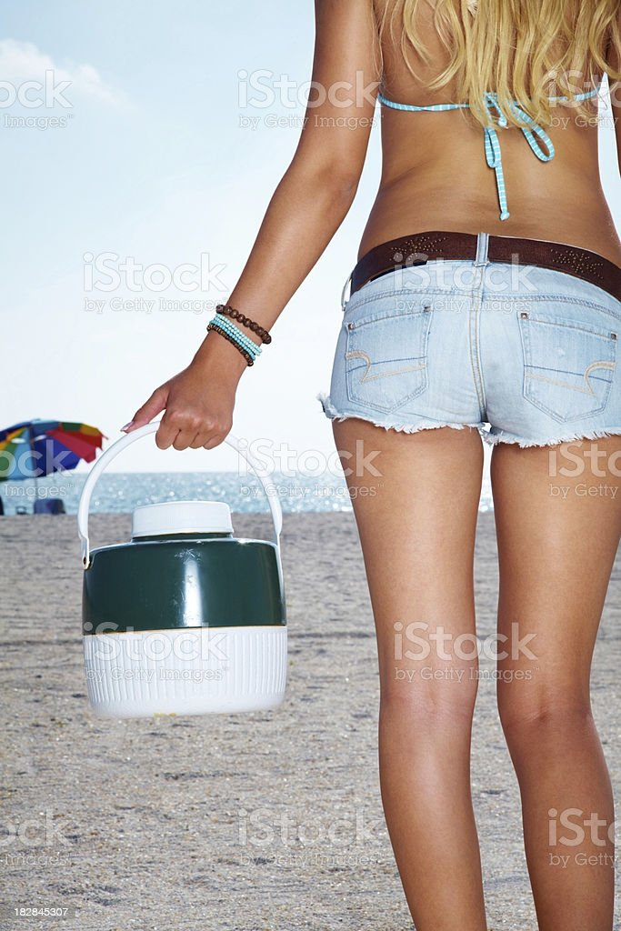 Mid section of a sexy woman with thermos royalty-free stock photo