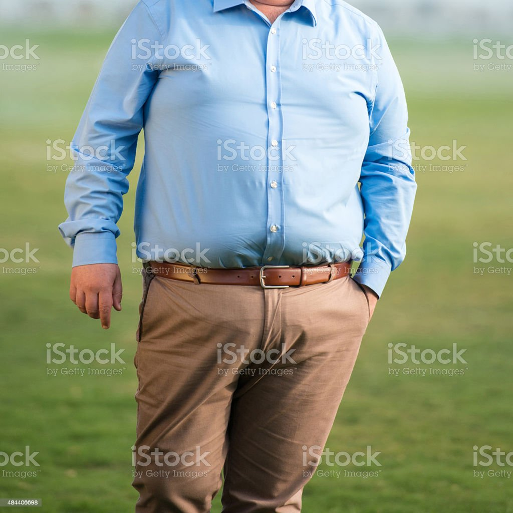 Mid section of an overweight mature man stock photo
