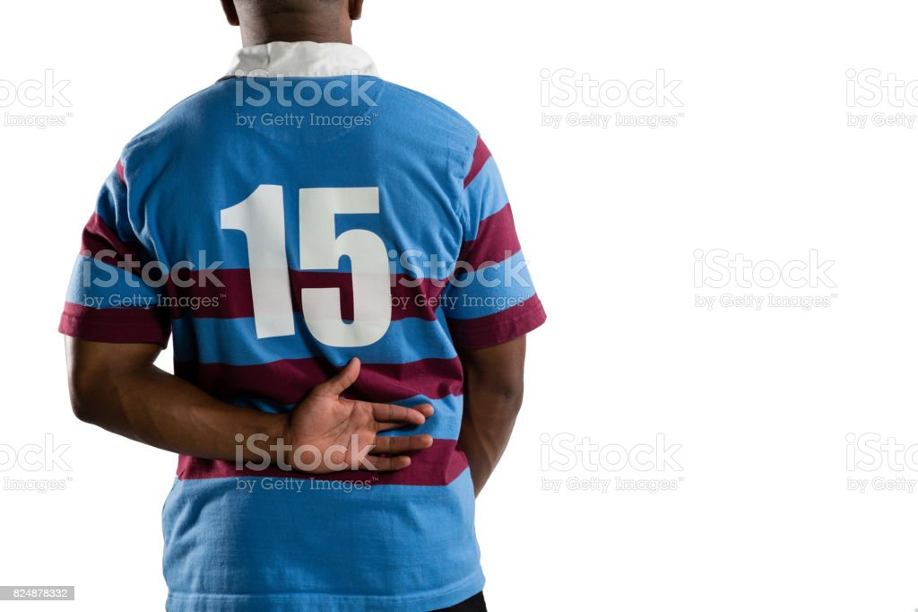 Mid section of male rugby player stock photo
