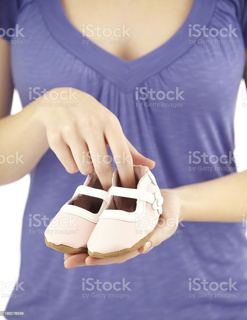 mid section of woman holding baby booties royalty-free stock photo