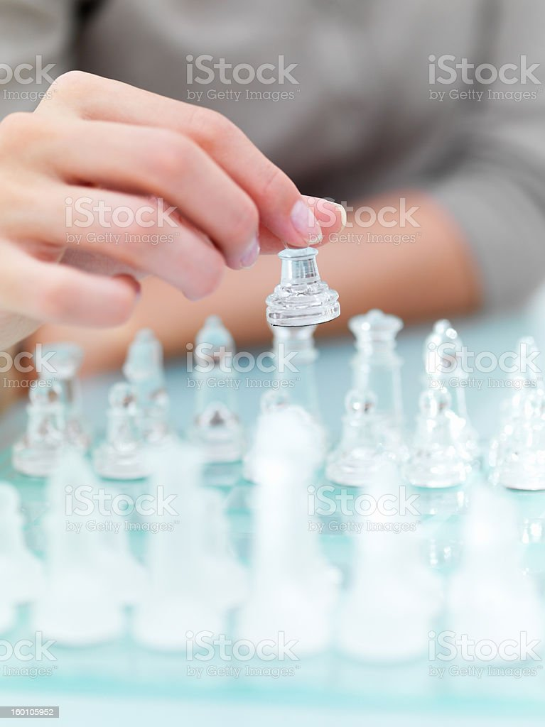 Mid section view of a woman playing chess royalty-free stock photo