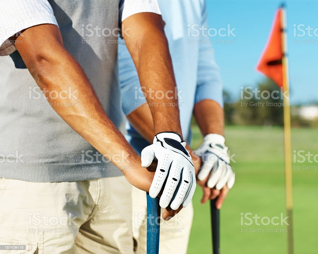 Mid section view of two male golfers stock photo