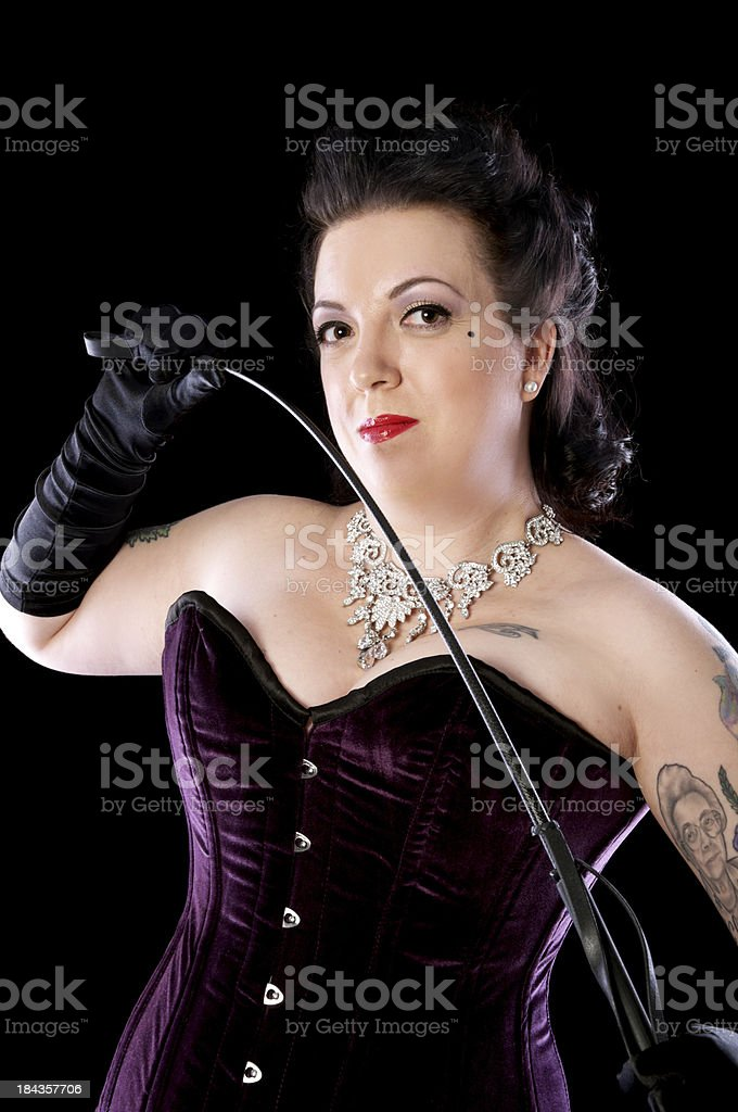 Mid thirties pinup with riding crop royalty-free stock photo