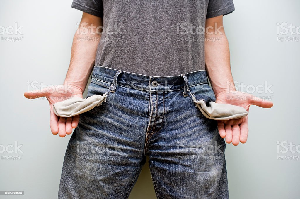 Mid view of man pulling out his empty jeans pockets for debt royalty-free stock photo