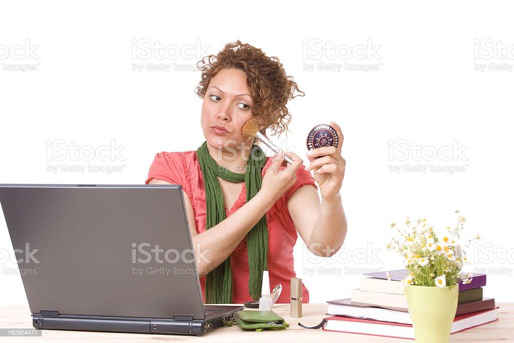 Mid-adult businesswoman applying powder brush royalty-free stock photo