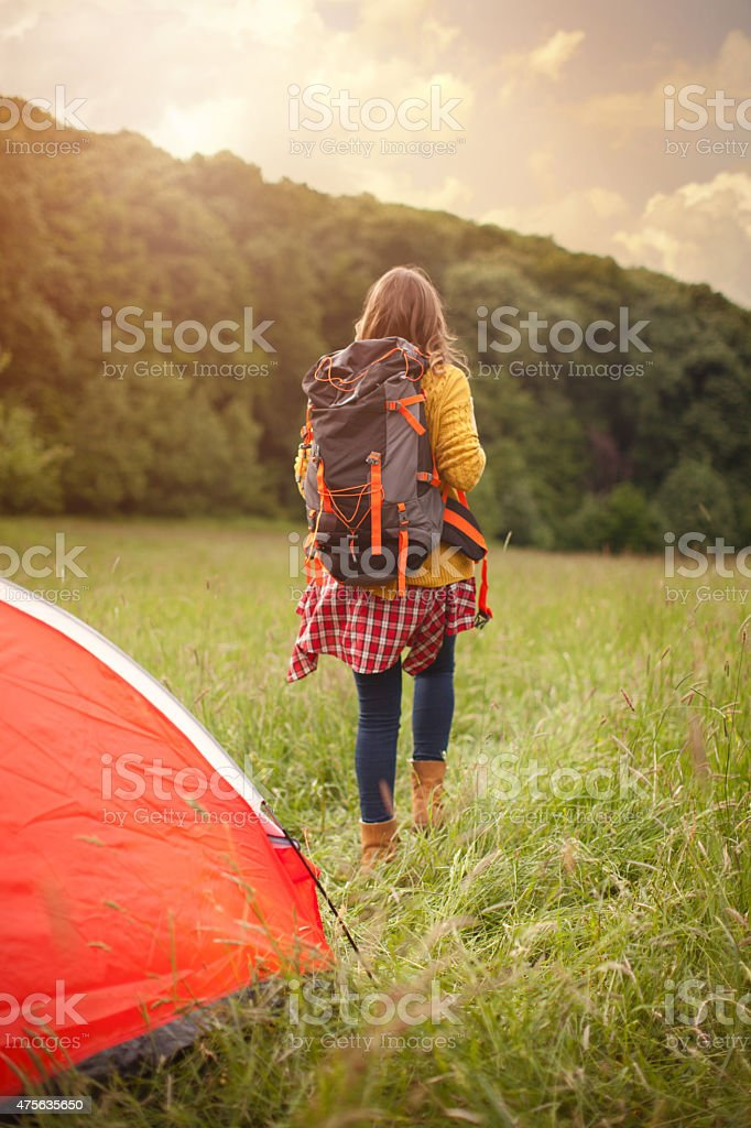 Midage woman camping in the forest. stock photo