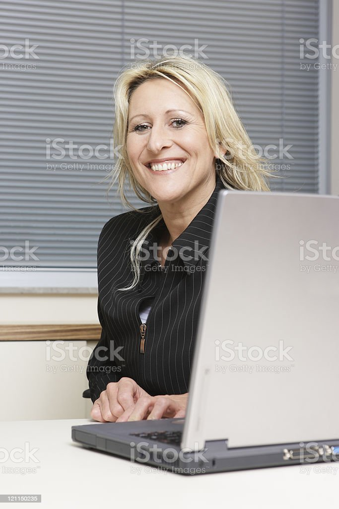 Mid-aged blonde in the office royalty-free stock photo