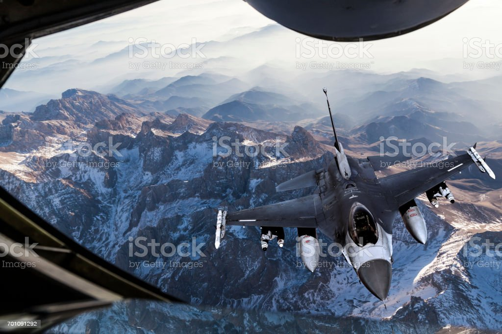 Mid-air Refueling over the mountains stock photo