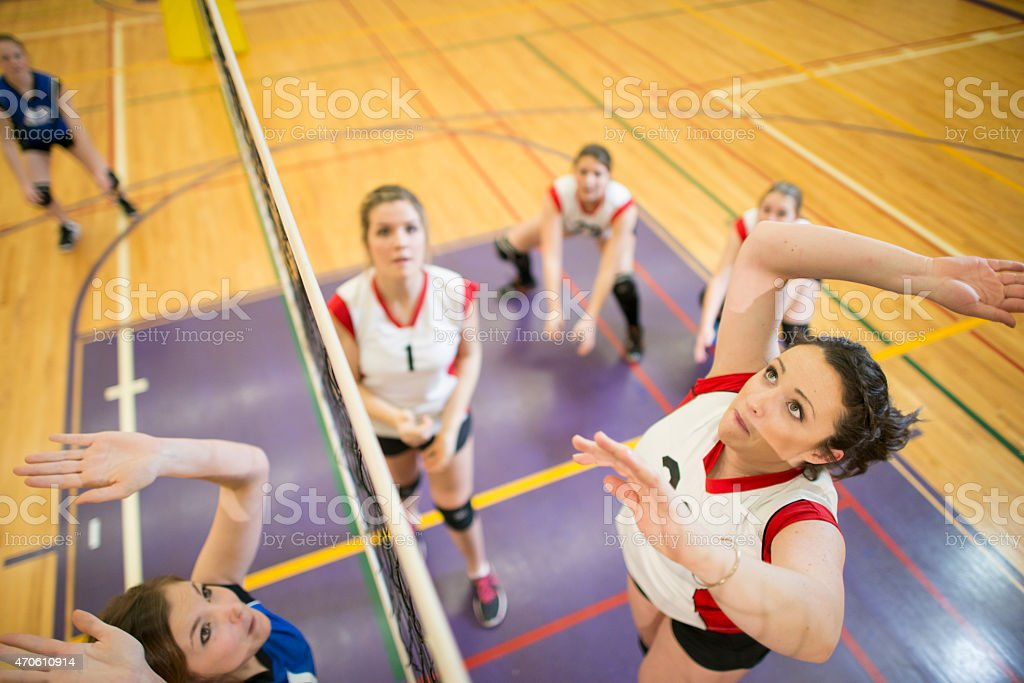 Mid-Air Volleyball Jump stock photo