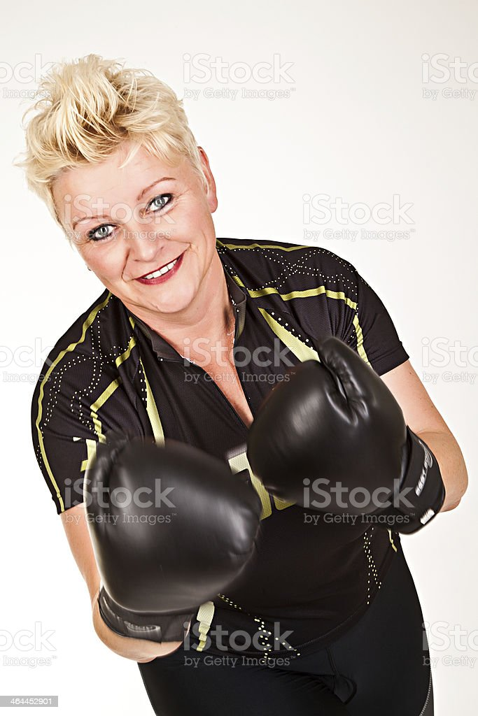 middelaged fitness woman boxing royalty-free stock photo