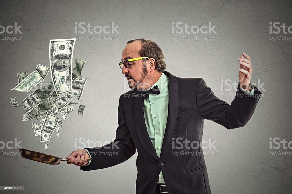 Middle age businessman juggling money dollar bills stock photo
