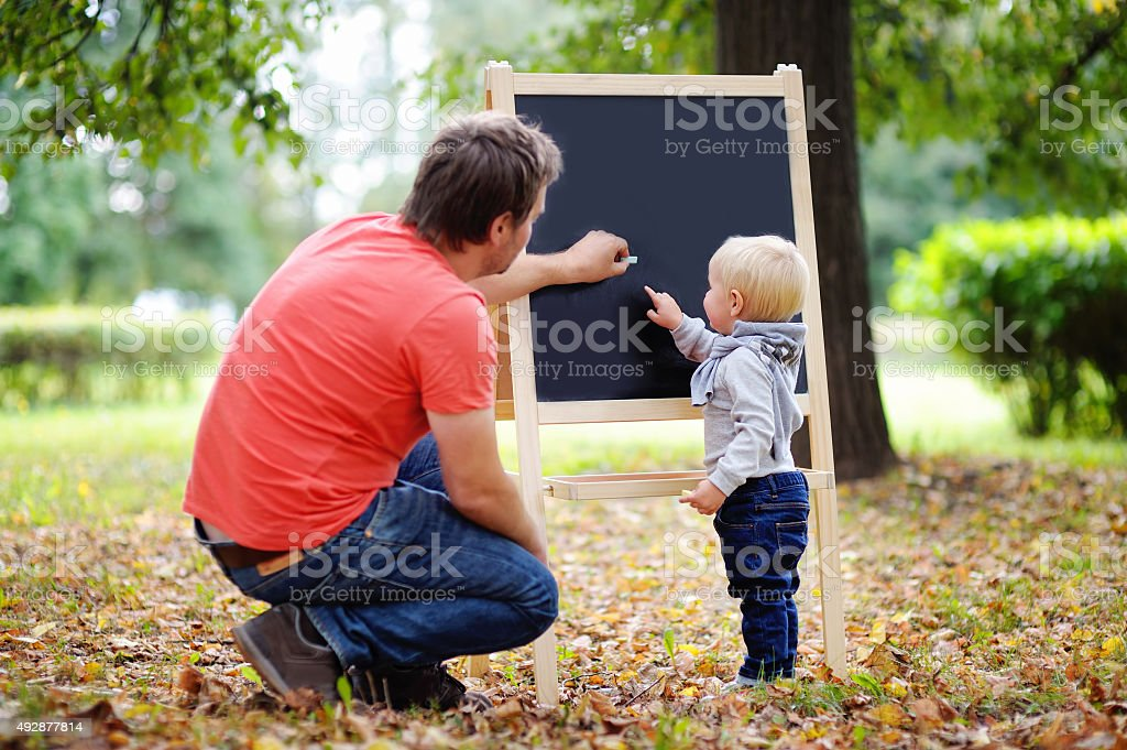 Middle age father and his toddler son stock photo