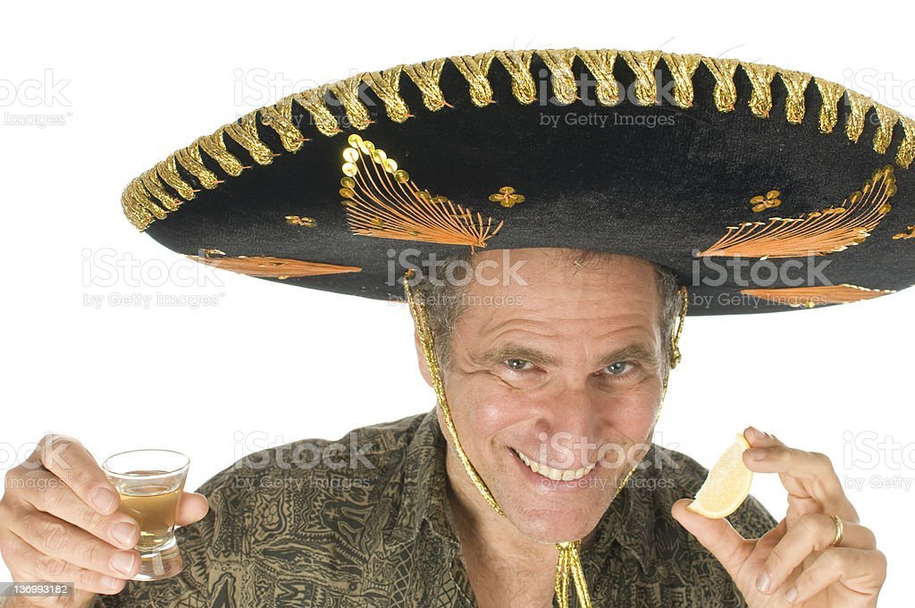 middle age male Mexican somebrero hat drinking tequila shot stock photo