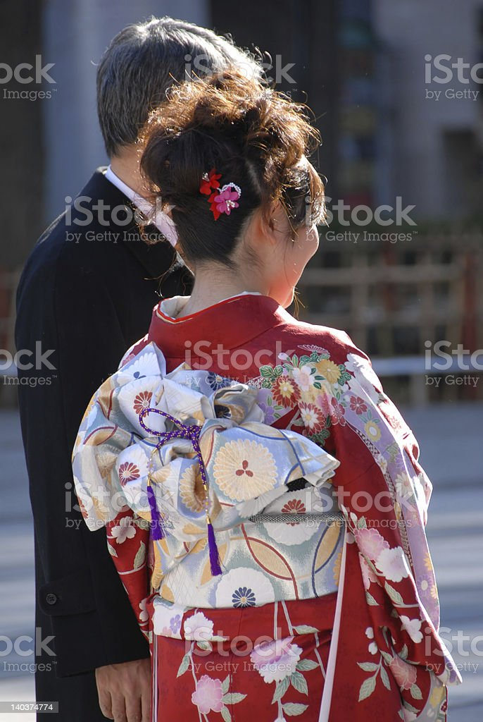 middle age man and young bride in kimono royalty-free stock photo