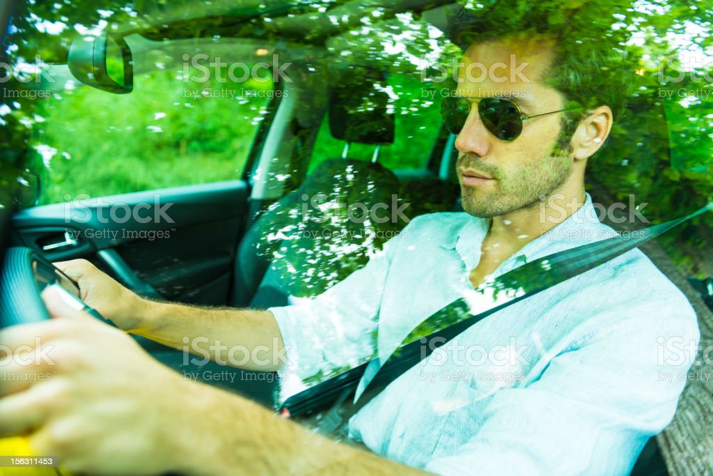Middle age man driving a car royalty-free stock photo