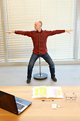 middle age man stretching arms, relaxing neck
