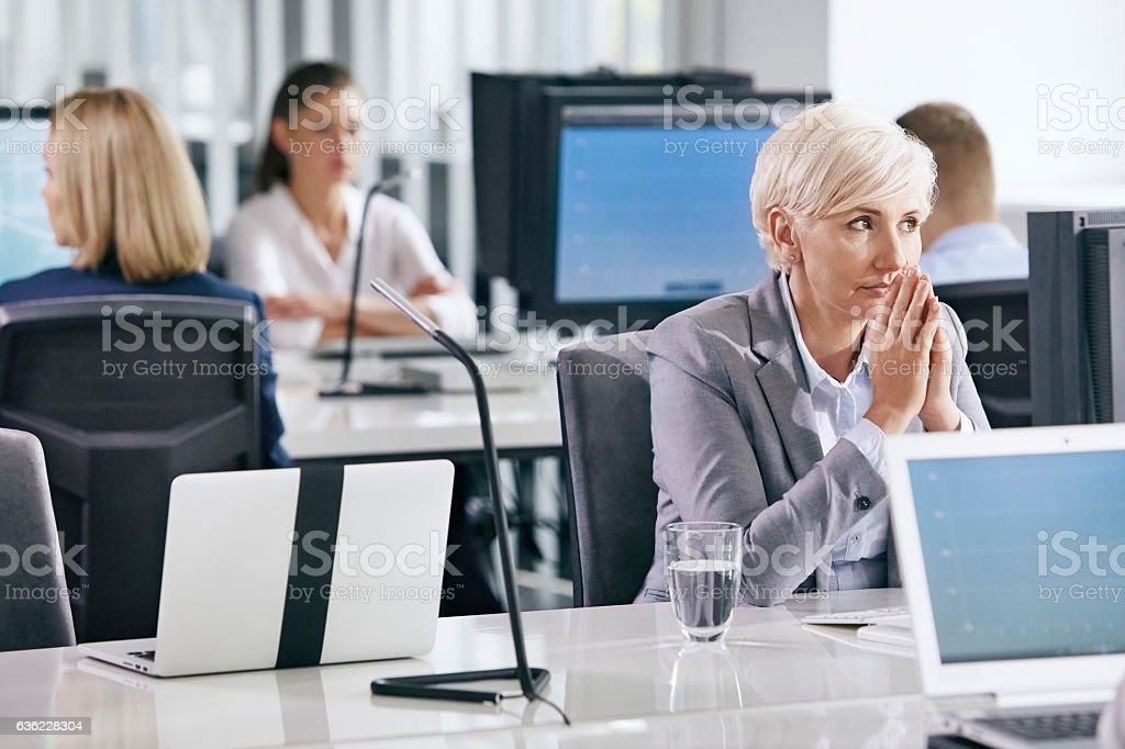 Middle age woman at work. Waiting for decisions. Doubts stock photo