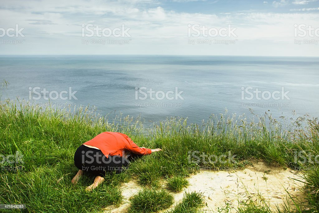 Middle age woman doing yoga exercise outdoors royalty-free stock photo