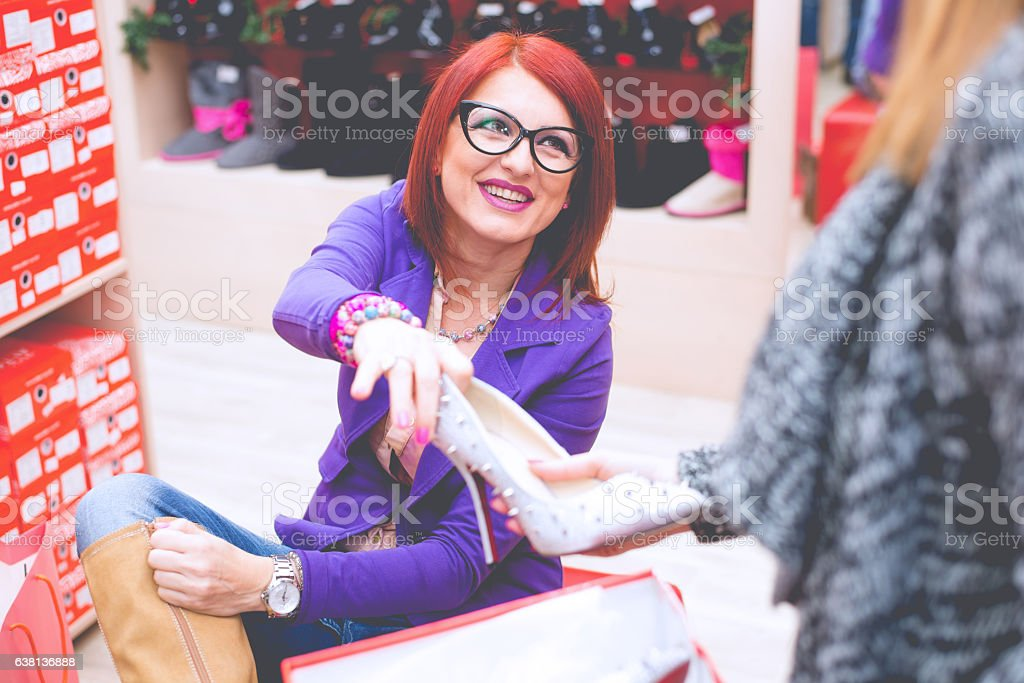 Middle age woman enjoy in shoes shopping stock photo