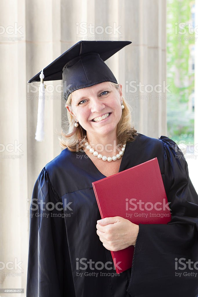 Middle Age Woman University Graduation Portrait Vertical royalty-free stock photo