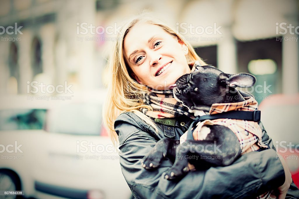 Middle age woman with puppy on the street stock photo