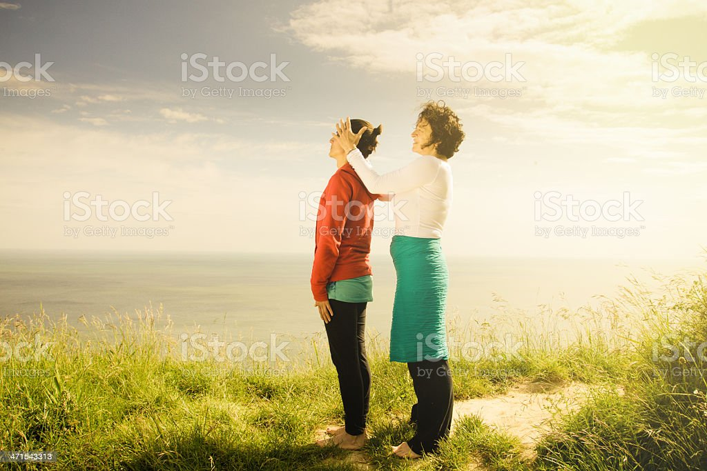 Middle age women doing yoga exercise outdoors royalty-free stock photo