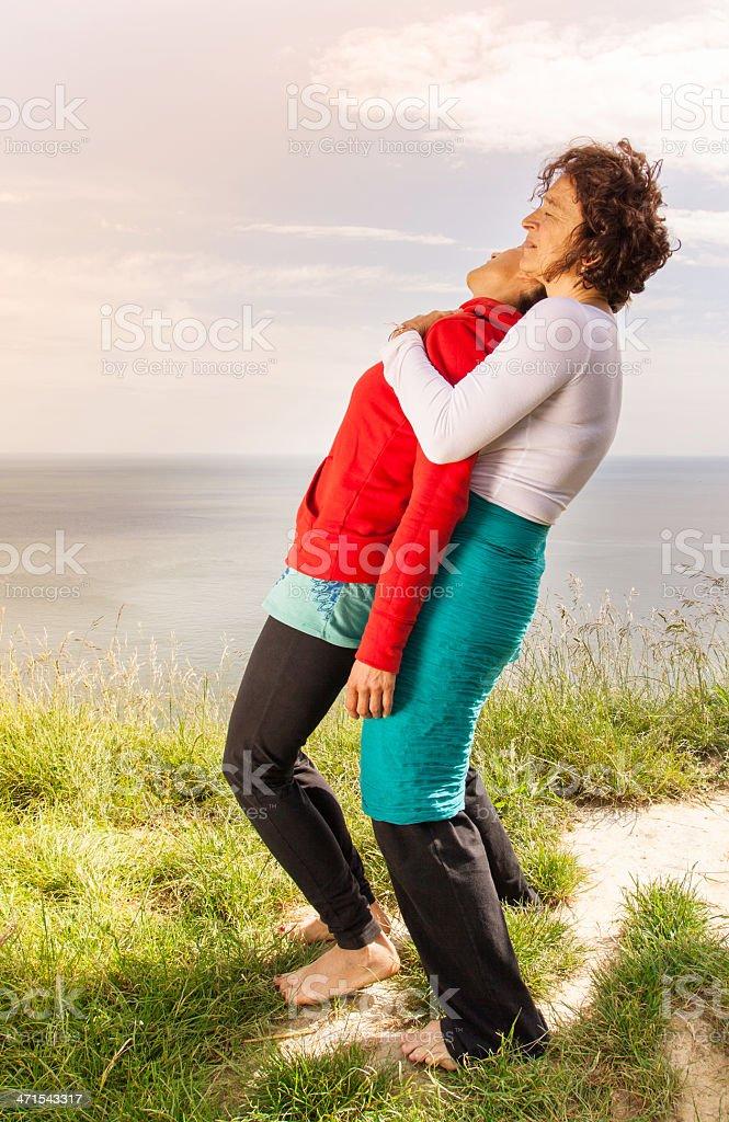 Middle age women doing yoga exercise outdoors royalty-free stock photo