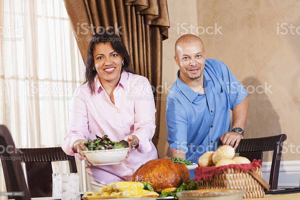 Middle aged African American couple serving holiday meal stock photo