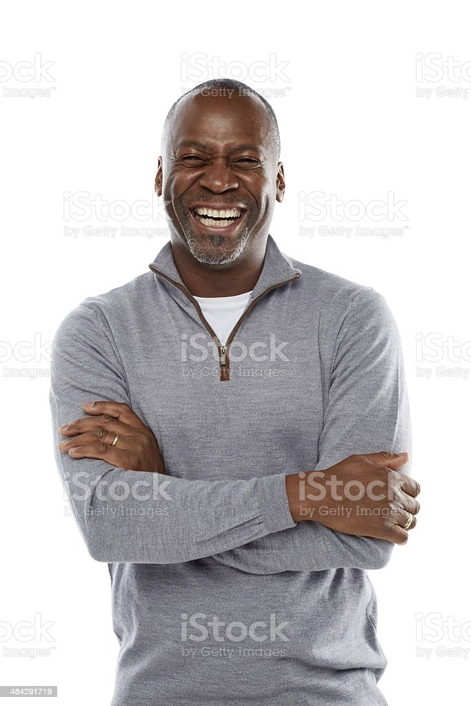 Middle aged african man laughing on white stock photo