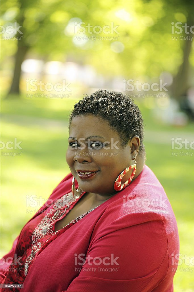 Middle Aged Black Woman Park Red Jacket stock photo
