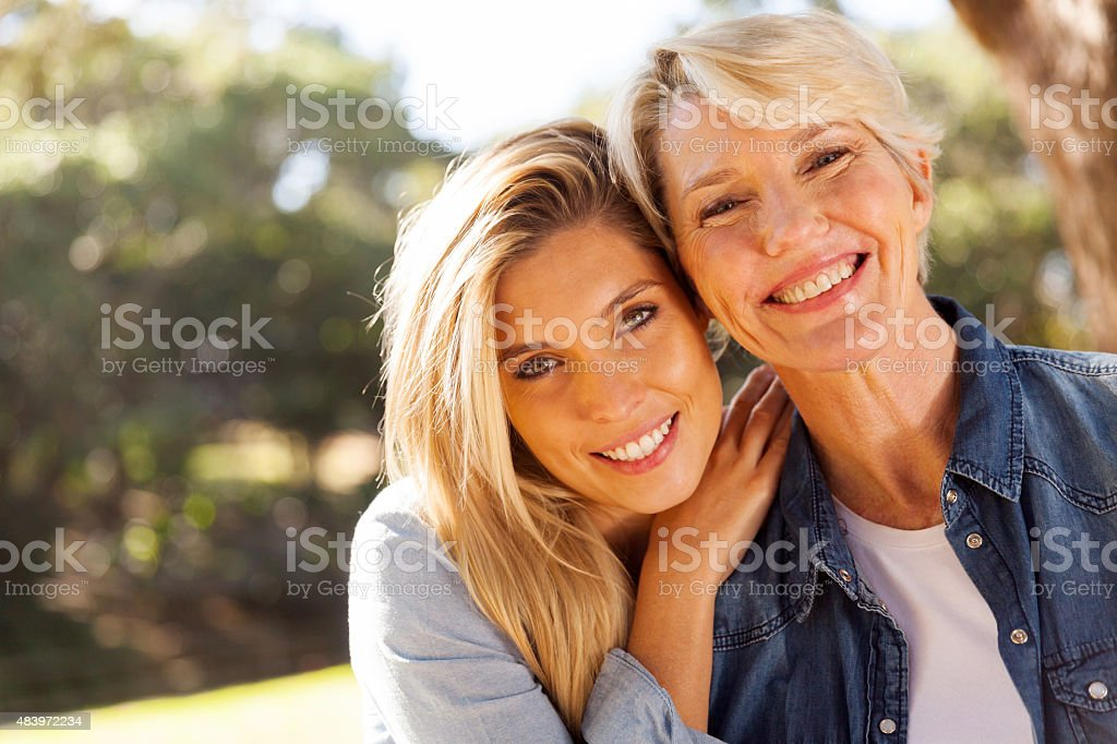 middle aged blond mother and adult daughter stock photo