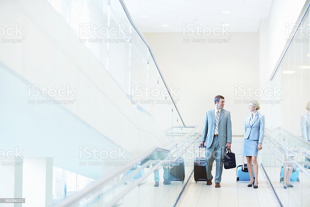 Middle aged business couple with travel bags at airport stock photo