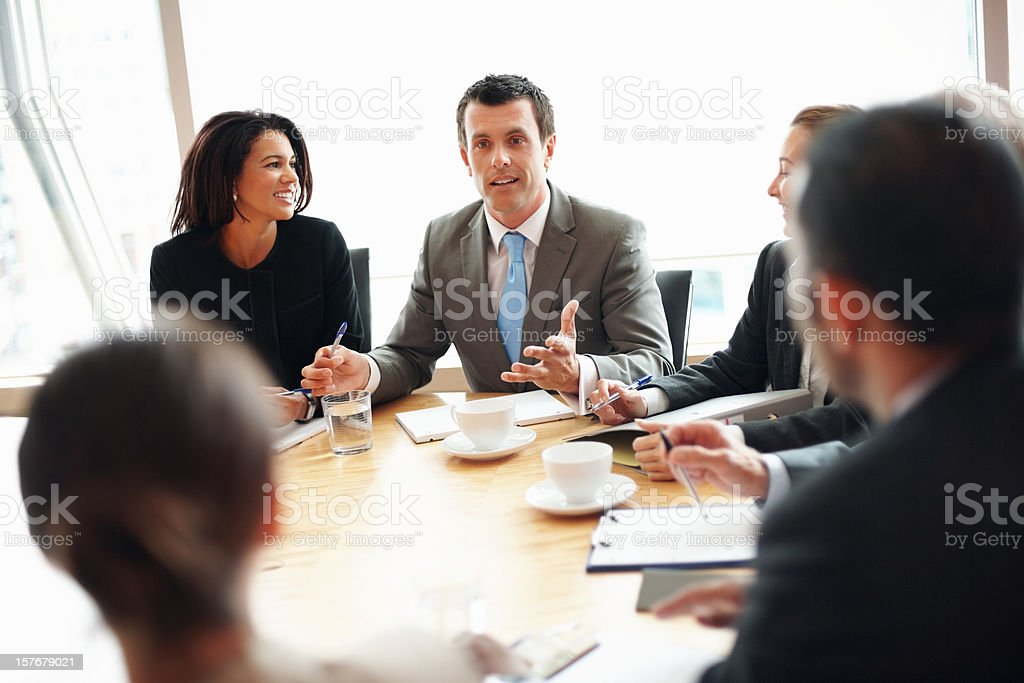 Middle aged business man discussing with his team in meeting royalty-free stock photo