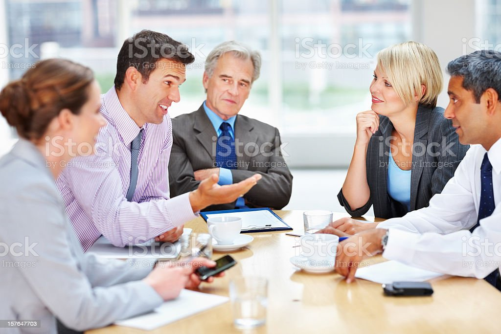 Middle aged business man discussing with his team royalty-free stock photo