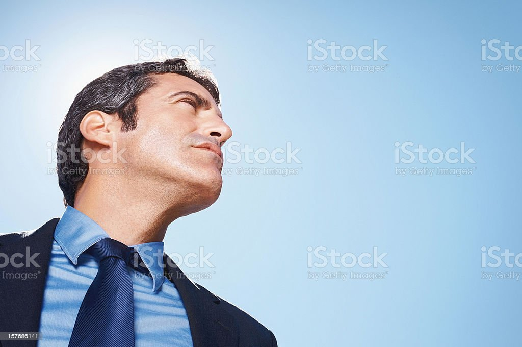 Middle aged business man looking against clear sky - copyspace royalty-free stock photo