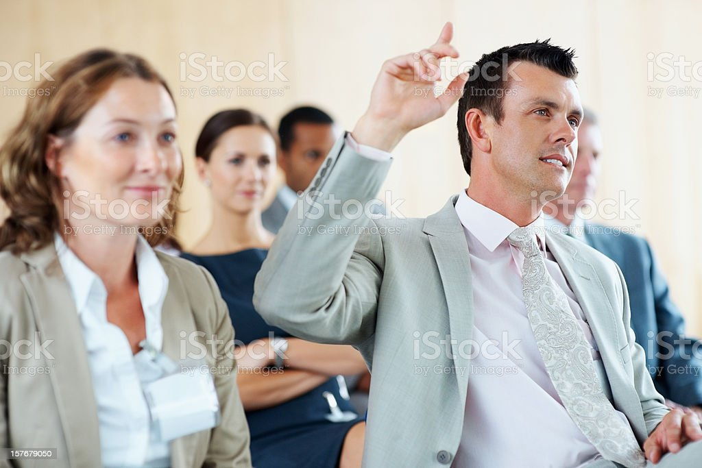 Middle aged business man raising hand to ask question royalty-free stock photo