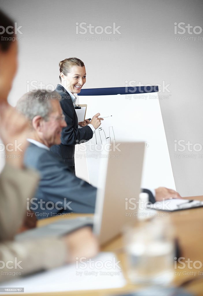 Middle aged business woman giving a presentation in meeting royalty-free stock photo