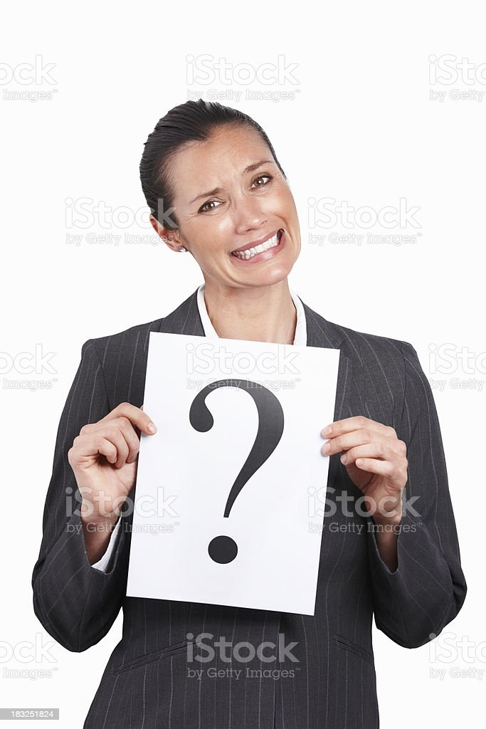 Middle aged business woman holding a sheet with question mark royalty-free stock photo