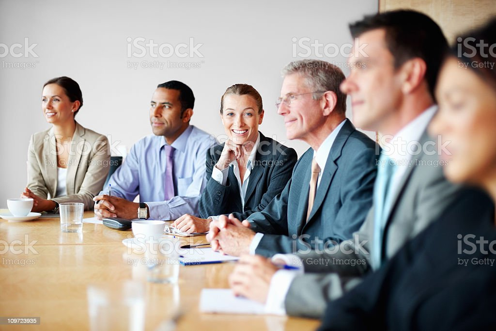 Middle aged business woman with her colleagues in a meeting royalty-free stock photo