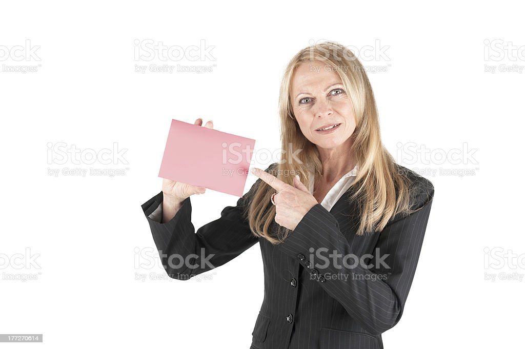 Middle aged business woman with pink slip stock photo