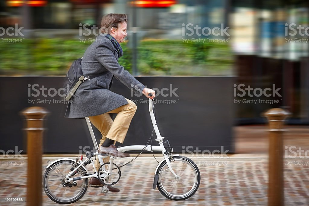 Middle aged businessman going to office by cycle stock photo