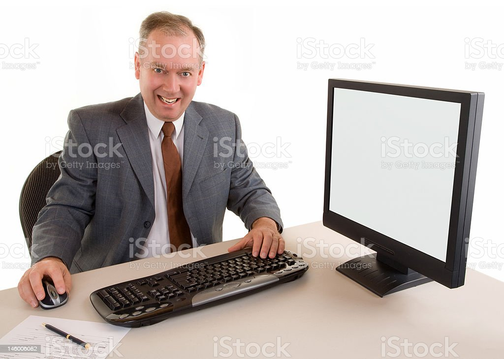 Middle Aged Businessman Sitting at his Desk royalty-free stock photo