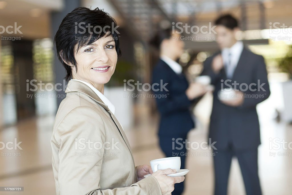 middle aged businesswoman having coffee royalty-free stock photo