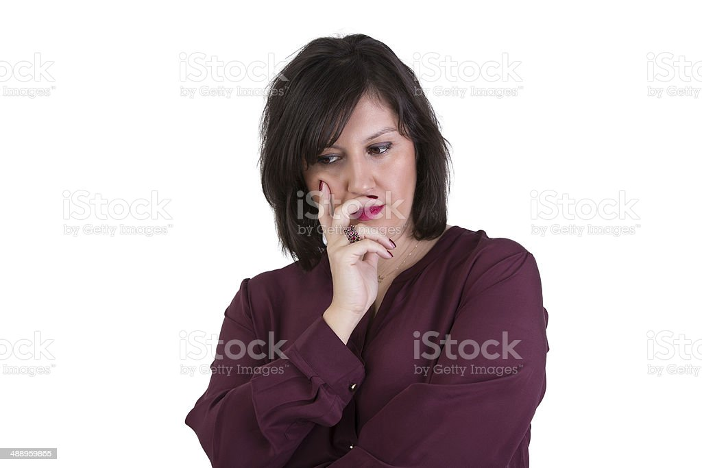 Middle Aged Businesswoman Looking down Thoughtfully stock photo